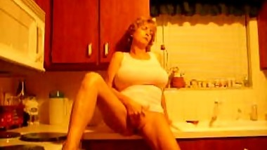 Mom films herself in the kitchen
