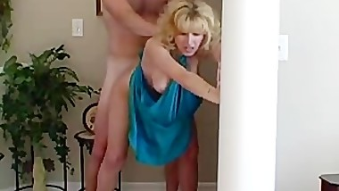 Housewife in blue dress gets it from behind