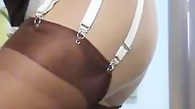 Slut Housewife Gives Upskirt Views In Brown Stockings In her Kitc