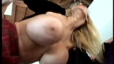 Tara Moon gets her huge silicon fake tits out, sucks and fucks.